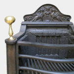 A POLISHED IRON FIREGRATE BY THOMAS ELSLEY