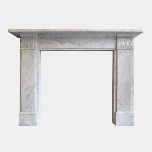 A Carrara Marble Regency Style Fireplace